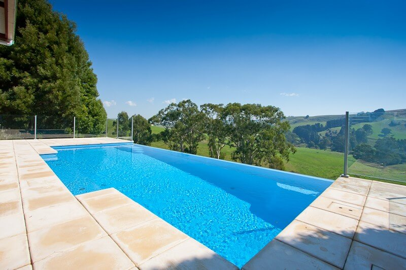 How Much Does an Infinity Edge Swimming Pool Cost? - Compass