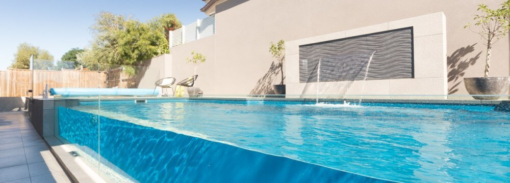 Compass Pools Melbourne Fibreglass pool with glass window and water feature