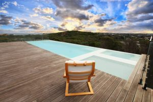 Compass Pools Melbourne 11 8m Xtrainer inifinity pool and spa with 3m Wader pool overview at sunset